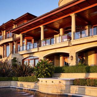 Imagen de piscina con fuente infinita, mediterránea, extra grande, a medida, en patio trasero, con adoquines de hormigón