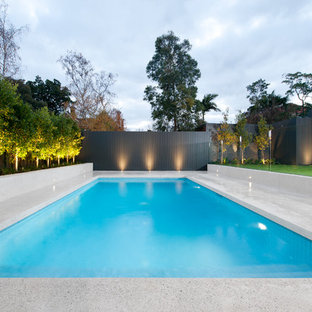 This is an example of a large modern backyard rectangular pool in Melbourne.