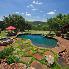 Traditional Pool by Land Design