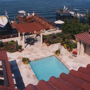 ニューヨークの中くらいの長方形地中海スタイルのおしゃれなプール (タイル敷き) の写真