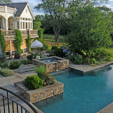Traditional Pool by I.Q. Landscape Architects