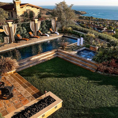 Hot tub - large mediterranean backyard rectangular lap hot tub idea in Orange County