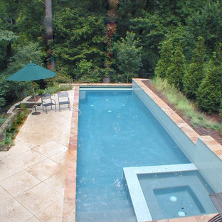 Lap pool fits on long skinny lot. Walls above and below pool make it work on hil