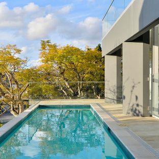 Design ideas for a contemporary side yard rectangular lap pool in Sydney with natural stone pavers.