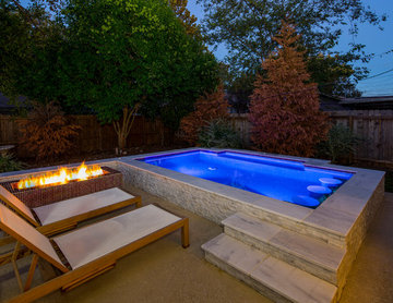 Large Downtown Modern Spa with Glass Tile Fire Feature