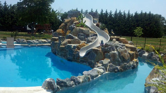 Large Pool with boulder waterfall ,water slide and a lazy river