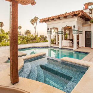 Inspiration for a large mediterranean backyard custom-shaped and stamped concrete lap hot tub remodel in Santa Barbara