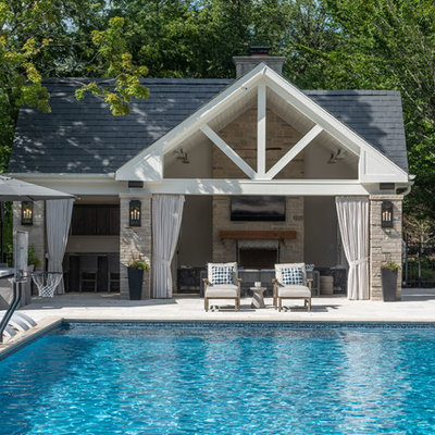Inspiration for a huge timeless backyard stone and rectangular pool house remodel in Chicago