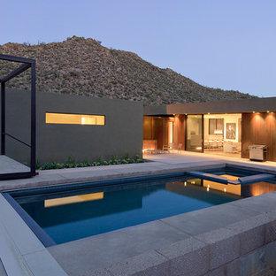 Ispirazione per una piscina moderna rettangolare