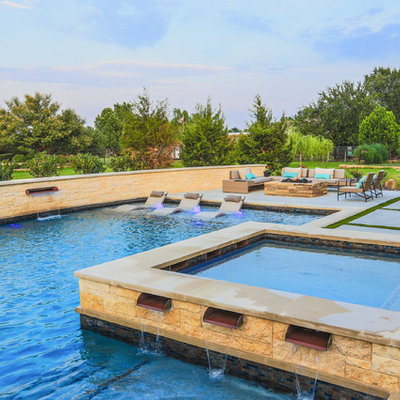 Example of a large trendy backyard concrete and l-shaped pool fountain design in Dallas