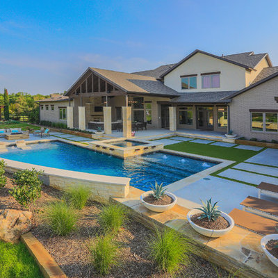 Hot tub - large transitional backyard concrete and l-shaped lap hot tub idea in Dallas