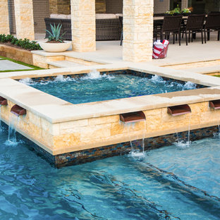 Example of a large transitional backyard concrete and l-shaped pool fountain design in Dallas