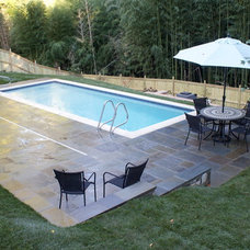 Traditional Pool by O'Grady's Landscape