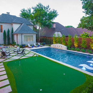 Design ideas for a medium sized mediterranean back rectangular lengths swimming pool in Dallas with natural stone paving and a water feature.