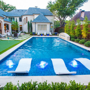 Photo of a medium sized mediterranean back rectangular lengths swimming pool in Dallas with a water feature and concrete paving.