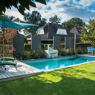 ハンブルクのトロピカルスタイルのおしゃれなプールの写真