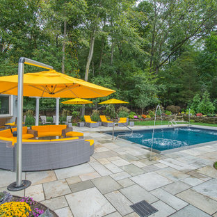 Inspiration for a contemporary backyard rectangular lap pool fountain remodel