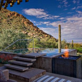 Imagen de piscina elevada, actual, rectangular