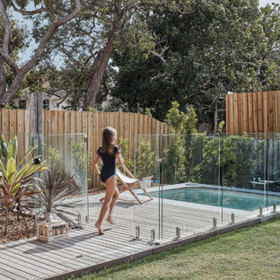 Design ideas for a beach style backyard rectangular pool in Gold Coast - Tweed with decking.
