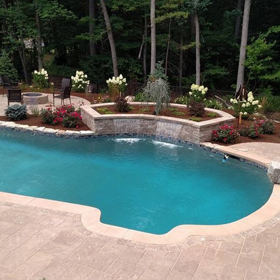 Inspiration for a mid-sized craftsman backyard concrete paver and custom-shaped natural pool fountain remodel in Boston