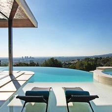 Contemporary Pool by Lori Dennis, ASID, LEED AP