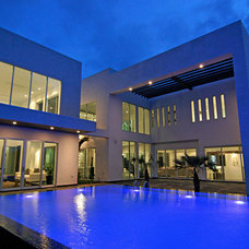 Modern Pool by Home & Commercial Designs