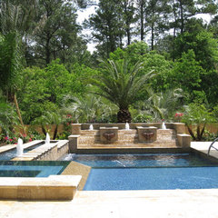 traditional pool by Omega Pools, LLC  281-330-6771