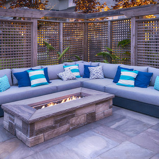 Mid-sized contemporary backyard rectangular pool in Toronto with natural stone pavers.