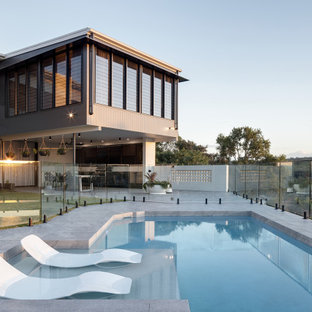 Design ideas for a large contemporary custom-shaped pool in Brisbane with tile.