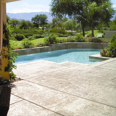 Mediterranean Pool Luxury swimming pool with a stamped concrete pool deck.
