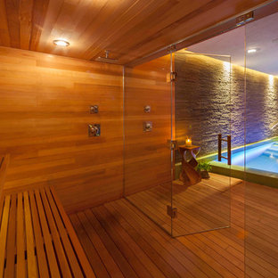 Inspiration for a contemporary indoor hot tub remodel in Other with decking