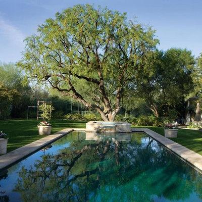 Hot tub - large mediterranean backyard concrete and rectangular lap hot tub idea in Phoenix