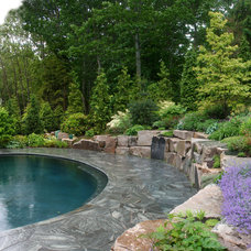 Rustic Pool by Woodburn & Company Landscape Architecture, LLC