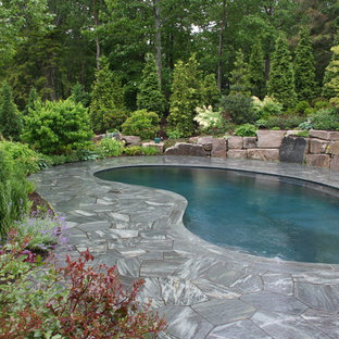 Inspiration for a timeless stone and kidney-shaped pool remodel in Manchester