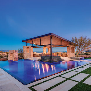 Inspiration for a large contemporary infinity pool fountain remodel in Phoenix