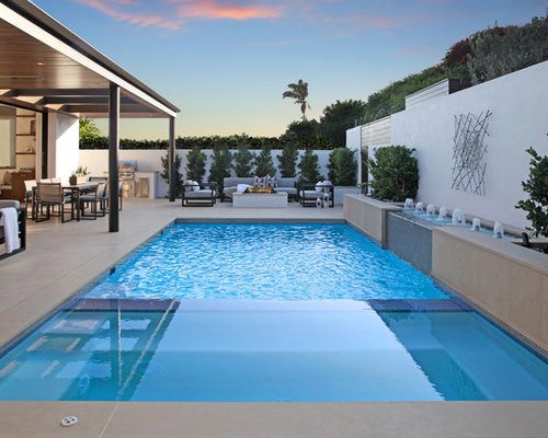 Inspiration For A Contemporary Backyard Concrete And Rectangular Lap Pool  Fountain Remodel In Orange County