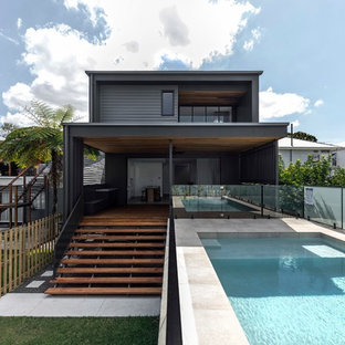 Photo of a contemporary backyard rectangular aboveground pool in Brisbane with decking.