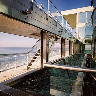 Pool - modern custom-shaped aboveground pool idea in Los Angeles