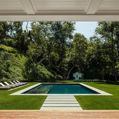Example of a classic backyard rectangular pool house design in Los Angeles