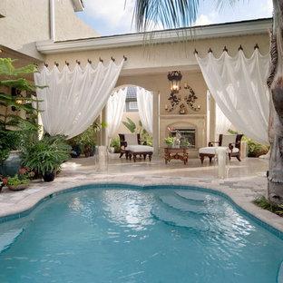 Pool - tropical custom-shaped pool idea in Orlando