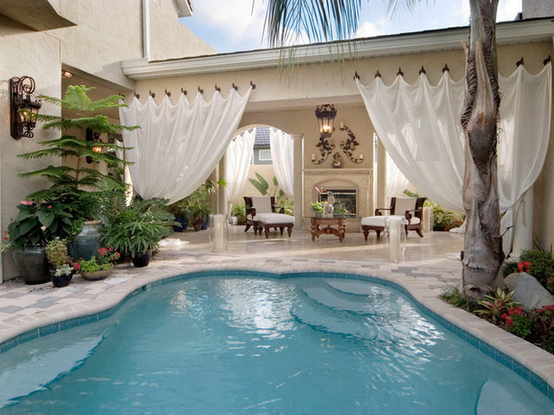 Tropical Swimming Pool by Silver Sea Homes