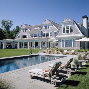 Inspiration pour une grand piscine arrière victorienne rectangle.