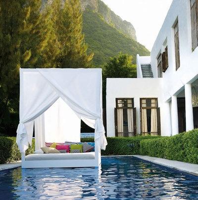 Mediterranean Swimming Pool by Raum + Textil Decoration