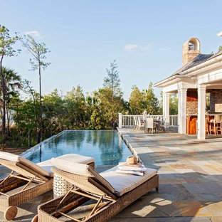 Example of a large classic backyard rectangular infinity pool design in Charleston