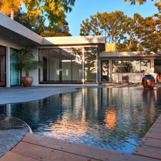 Midcentury Exterior by Tuggey Construction