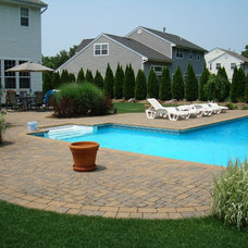 Traditional Pool by C & I Concrete and Masonry