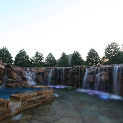 Inspiration for a small rustic backyard custom-shaped natural hot tub remodel in Oklahoma City