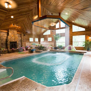 Mountain style indoor tile and custom-shaped pool photo in Other