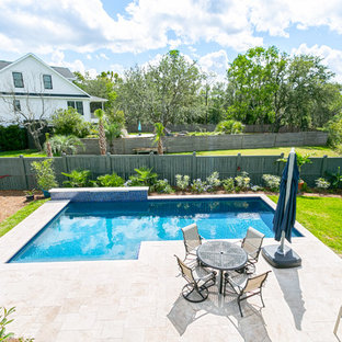 Inspiration for a mid-sized beach style backyard l-shaped natural pool in Charleston with a water feature and tile.