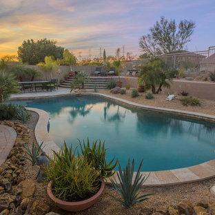Mittelgroßes Mediterranes Pool mit Kies hinter dem Haus in individueller Form in Phoenix